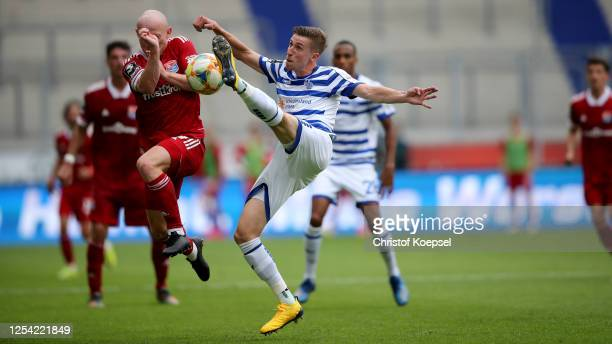 Maximilian Krauss of Unterhaching challenges Arne Sicker of Duisburg during the 3 Liga match between MSV Duisburg and SpVgg Unterhaching at...