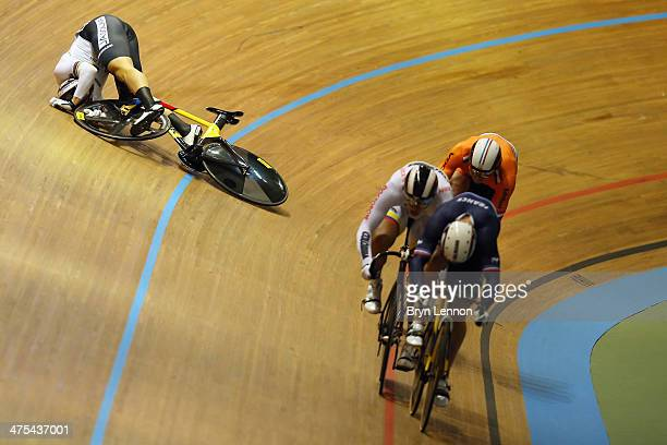 Maximilian Levy of Germany crashes out of the Men's Keirin on day two of the 2014 UCI Track Cycling World Championships at the Velodromo Alcides...