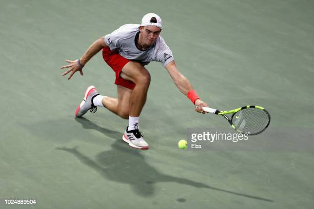 Maximilian Marterer of Germany returns the ball during his men's singles first round match against Kei Nishikori of Japan on Day Two of the 2018 US...