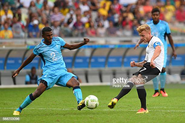 Maximilian Meyer of Germany shoots the ball past Praneel Naidu of Fiji during the Men's First Round Football Group C match between Germany and Fiji...