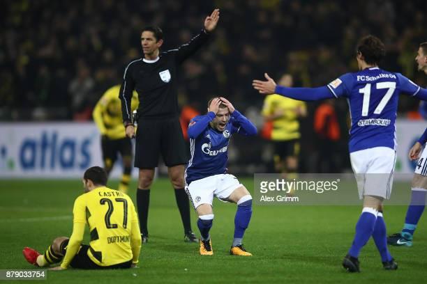 Maximilian Meyer of Schalke reacts after referee Deniz Aytekin decided for a free kick during the Bundesliga match between Borussia Dortmund and FC...