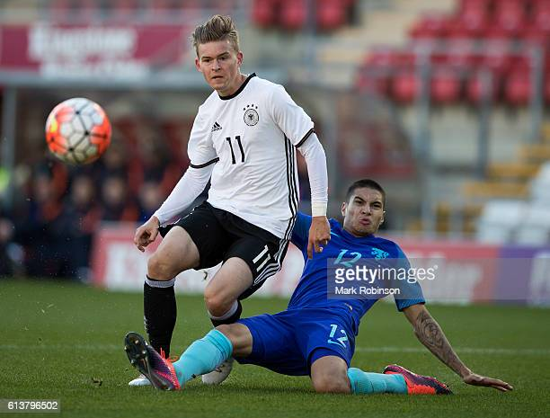 Maximilian Mittelstadt of Germany U20 shoots at goal under a change from Kevin Diks of the Netherlands U20 during the U20 International Friendly...