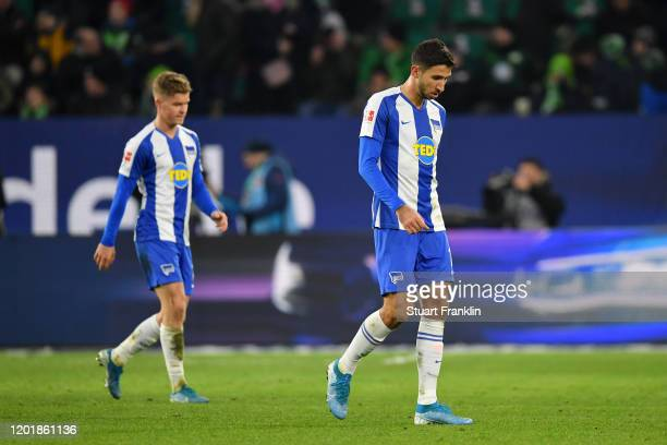 Maximilian Mittelstadt of Hertha BSC and Marko Grujic of Hertha BSC leave the pitch looking dejected at half time during the Bundesliga match between...