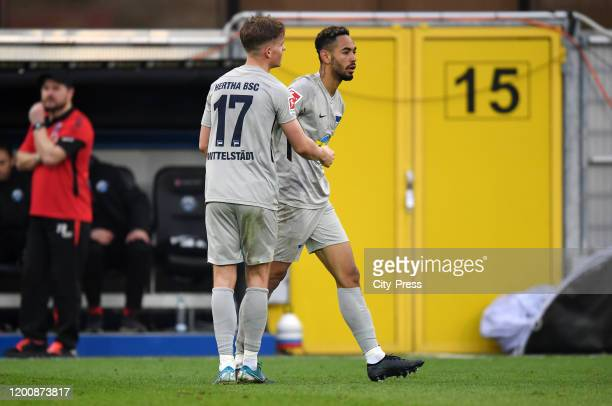 Maximilian Mittelstaedt and Matheus Cunha of Hertha BSC celebrate after scoring the 12 during the game between the SC Paderborn 07 against Hertha BSC...