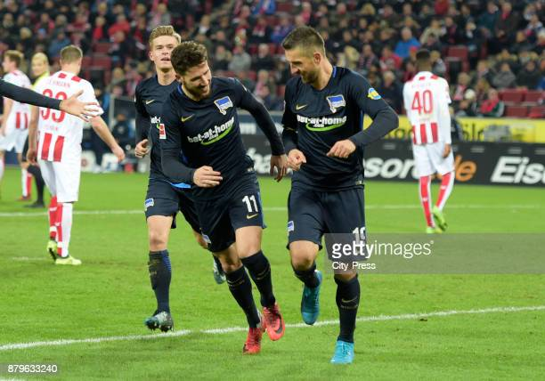Maximilian Mittelstaedt Mathew Leckie and Vedad Ibisevic of Hertha BSC celebrate after scoring the 02 during the game between 1 FC Koeln and Hertha...
