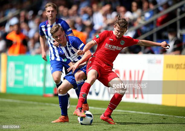 Maximilian Mittelstaedt of Berlin challenges Jonas Morison of Hanover during the DFB Juniors Cup Final 2016 between Hertha BSC U19 and Hannover 96...