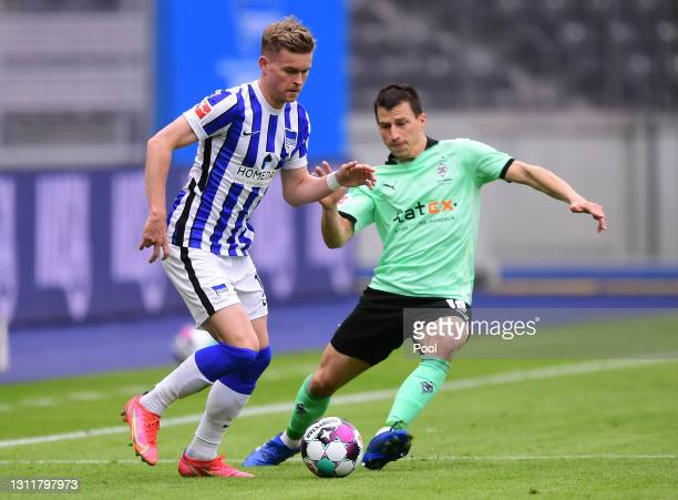 Maximilian Mittelstaedt of Hertha Berlin is put under pressure by Stefan Lainer of Borussia Moenchengladbach during the Bundesliga match between...