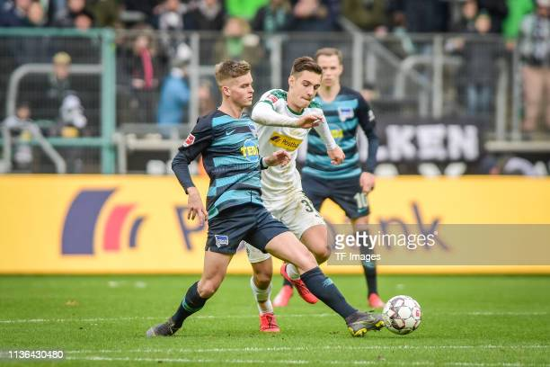 Maximilian Mittelstaedt of Hertha BSC Berlin and Florian Neuhaus of Borussia Moenchengladbach battle for the ball during the Bundesliga match between...