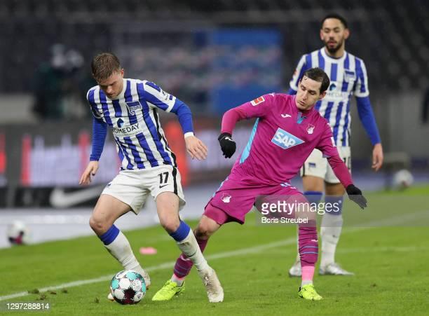 Maximilian Mittelstädt of Hertha Berlin is tackled by Sebastian Rudy of TSG Hoffenheim during the Bundesliga match between Hertha BSC and TSG...