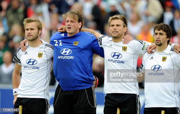 Maximilian Mueller Max Weinhold Moritz Fuerste Tobias Hauke of Germany stand together prior to the EuroHockey 2011 final match between Netherlands...