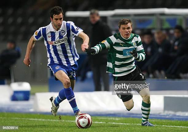 Maximilian Nicu of Berlin battles for the ball with Marat Izmailov of Lissabon during the UEFA Europa League match between Hertha BSC Berlin and...