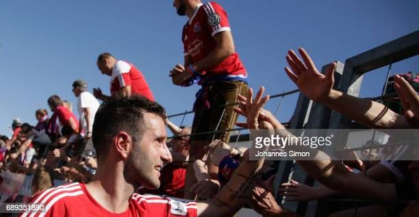 Maximilian Nicu of Unterhaching celebrates with fans after the third league playoff leg one match at Alenbauer Sportpark on May 28 2017 in...