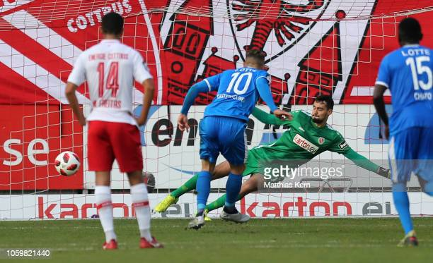 Maximilian Oesterhelweg of Lotte scores his team's first goal after penalty during the 3. Liga match between FC Energie Cottbus and VfL Sportfreunde...
