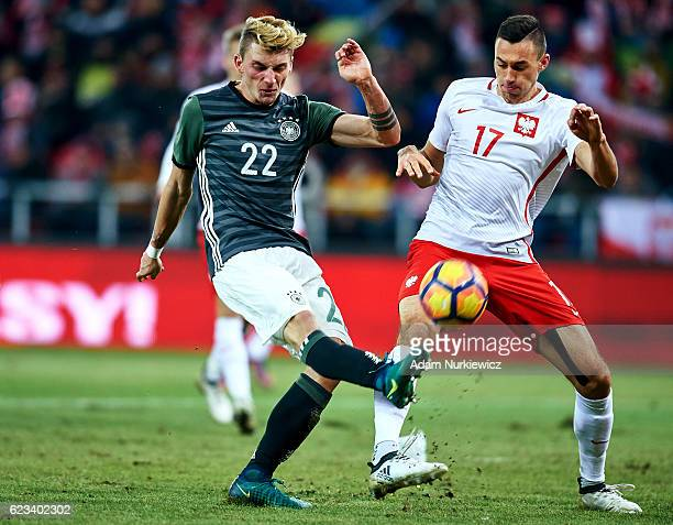 Maximilian Philipp from Germany fights for the ball with Jaroslaw Jach from Poland during the International Friendly soccer match between Poland U21...