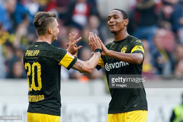Maximilian Philipp of Borussia Dortmund celebrates after scoring his team`s fourth goal with Abdou Diallo of Borussia Dortmund during the Bundesliga...