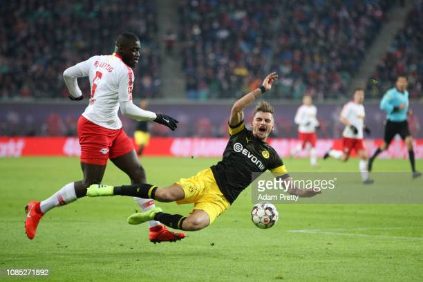 Maximilian Philipp of Borussia Dortmund is tackled by Dayot Upamecano of RB Leipzig during the Bundesliga match between RB Leipzig and Borussia...