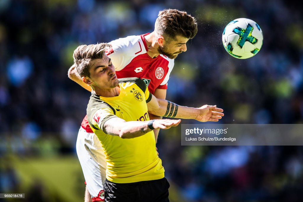 Maximilian Philipp (L) of Dortmund and Alexander Hack (R) of Mainz head the ball during the Bundesliga match between Borussia Dortmund and 1. FSV Mainz 05 at Signal Iduna Park on May 5, 2018 in Dortmund, Germany.