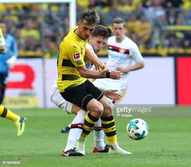 Maximilian Philipp of Dortmund and Panagiotis Retsos of Leverkusen battle for the ball during the Bundesliga match between Borussia Dortmund and...