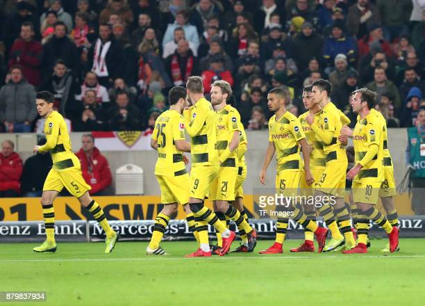 Maximilian Philipp of Dortmund celebrates after scoring his team`s first goal with Marc Bartra Aregall of Dortmund Sokratis Papastathopoulos of...