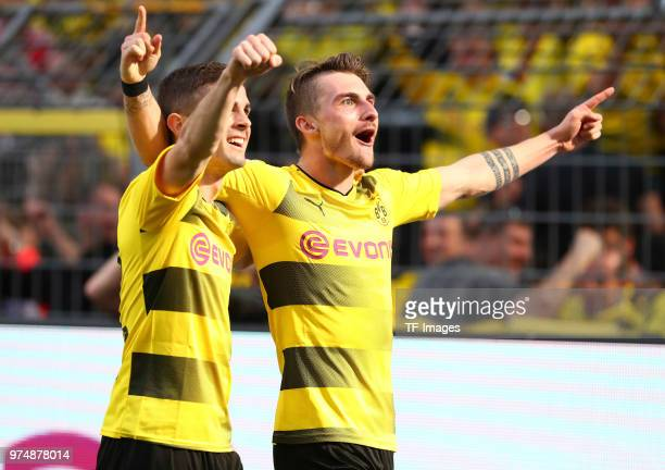 Maximilian Philipp of Dortmund celebrates after scoring his team`s third goal with Christian Pulisic of Dortmund during the Bundesliga match between...