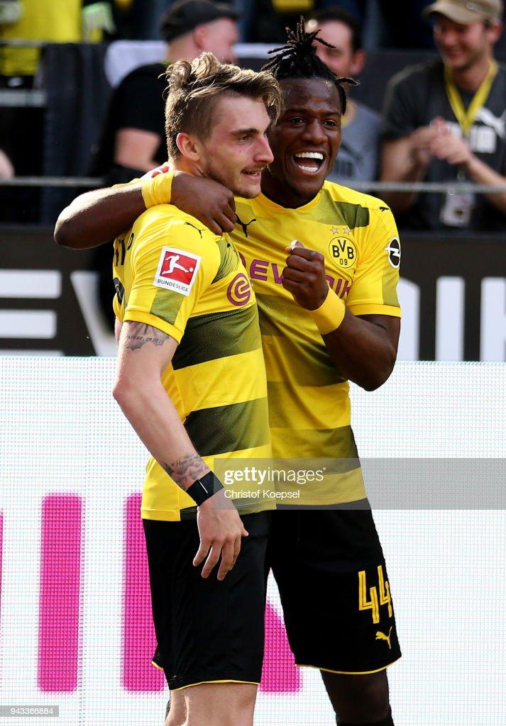 Maximilian Philipp of Dortmund celebrates the third goal with Michy Batshuayi of Dortmund during the Bundesliga match between Borussia Dortmund and VfB Stuttgart at Signal Iduna Park on April 8, 2018 in Dortmund, Germany.