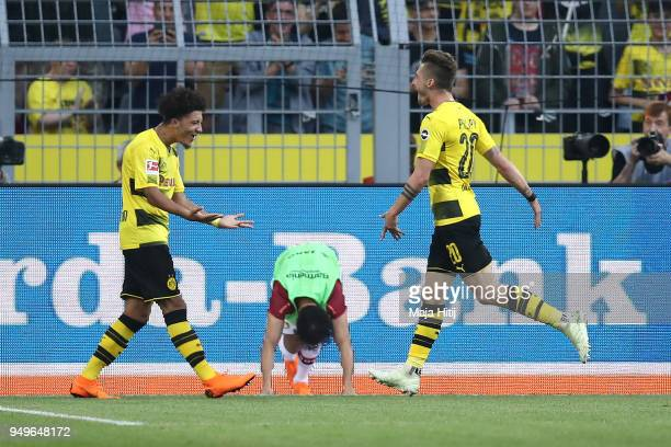 Maximilian Philipp of Dortmund celebrates with Jadon Malik Sancho of Dortmund after he scored a goal to make it 30 during the Bundesliga match...