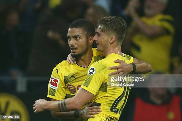 Maximilian Philipp of Dortmund celebrates with Jeremy Toljan of Dortmund after the scored to make it 20 during the Bundesliga match between Borussia...