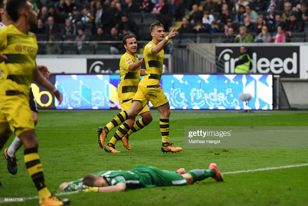 Maximilian Philipp of Dortmund (r) celebrates with Mario Goetze of Dortmund after he scored his teams second goal to make it 2:0 during the Bundesliga match between Eintracht Frankfurt and Borussia Dortmund at Commerzbank-Arena on October 21, 2017 in Frankfurt am Main, Germany.