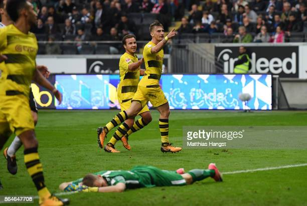 Maximilian Philipp of Dortmund celebrates with Mario Goetze of Dortmund after he scored his teams second goal to make it 20 during the Bundesliga...
