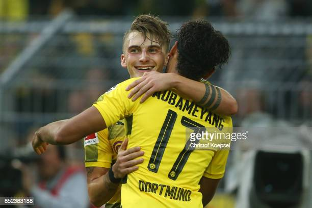Maximilian Philipp of Dortmund celebrates with PierreEmerick Aubameyang of Dortmund after he scored his teams first goal to make it 10 during the...