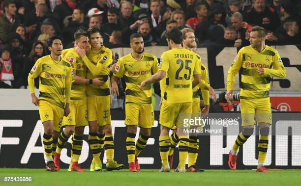 Maximilian Philipp of Dortmund celebrates with team mates after scoring his teams first goal during the Bundesliga match between VfB Stuttgart and...