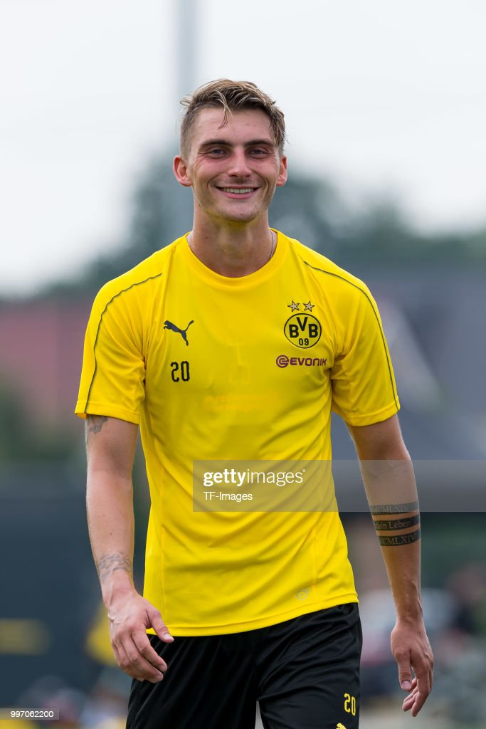 Maximilian Philipp of Dortmund laughs during a training session at BVB training center on July 12, 2018 in Dortmund, Germany.