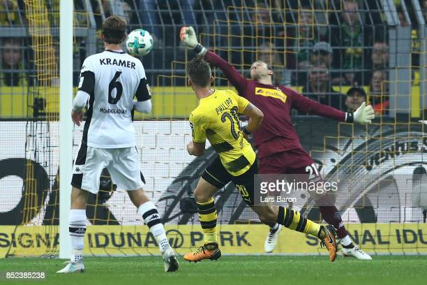 Maximilian Philipp of Dortmund scores his teams second goal past goalkeeper Tobias Sippel of Moenchengladbach to make it 20 during the Bundesliga...