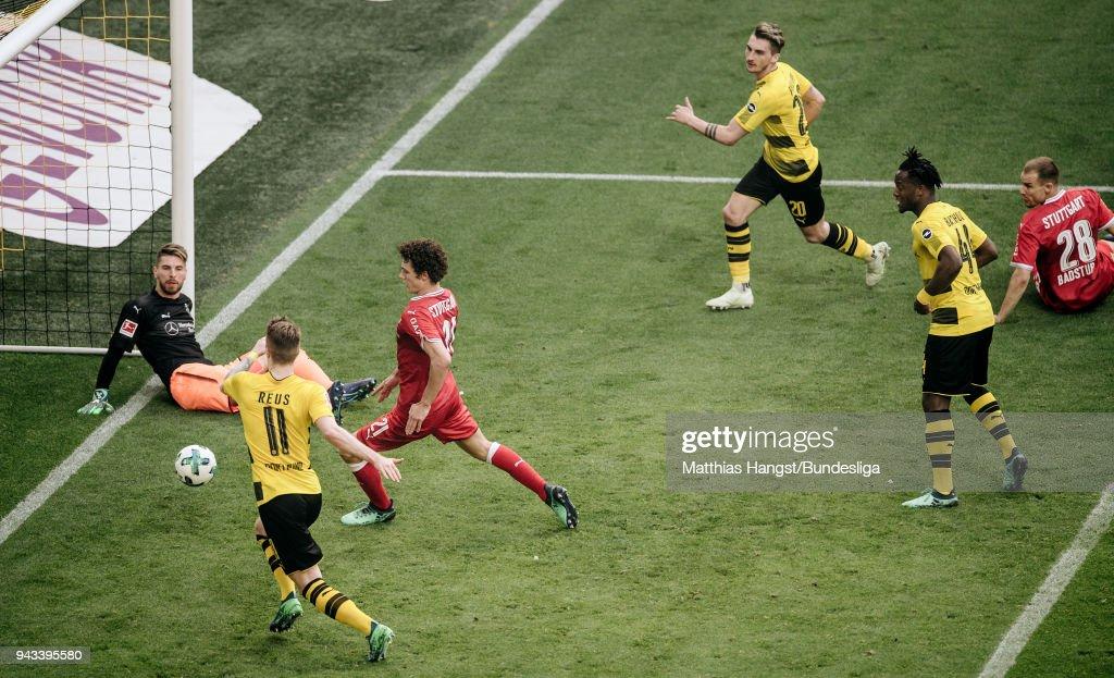 Maximilian Philipp of Dortmund scores his team's third goal past goalkeeper Ron-Robert Zieler of Stuttgart during the Bundesliga match between Borussia Dortmund and VfB Stuttgart at Signal Iduna Park on April 8, 2018 in Dortmund, Germany.