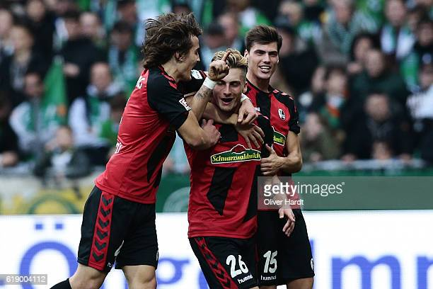 Maximilian Philipp of Freiburg celebrates scoring the opening goal with his team mates during the Bundesliga match between Werder Bremen and SC...