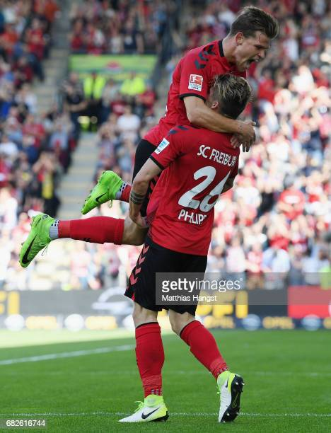 Maximilian Philipp of Freiburg celebrates with his teammate Florian Niederlechner of Freiburg after scoring his team's first goal during the...