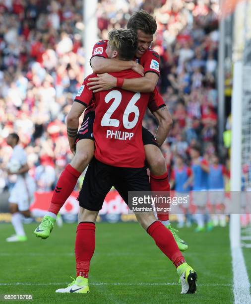 Maximilian Philipp of Freiburg celebrates with his team-mate Florian Niederlechner of Freiburg after scoring his team's first goal during the...