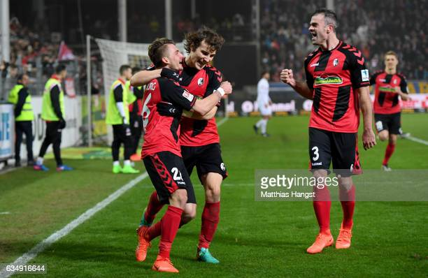 Maximilian Philipp of Freiburg celebrates with team mates after scoring his teams second goal during the Bundesliga match between SC Freiburg and 1...