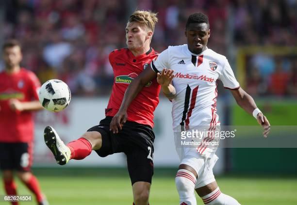 Maximilian Philipp of Freiburg is challenged by Bernardo de Oliveira of Ingolstadt during the Bundesliga match between SC Freiburg and FC Ingolstadt...