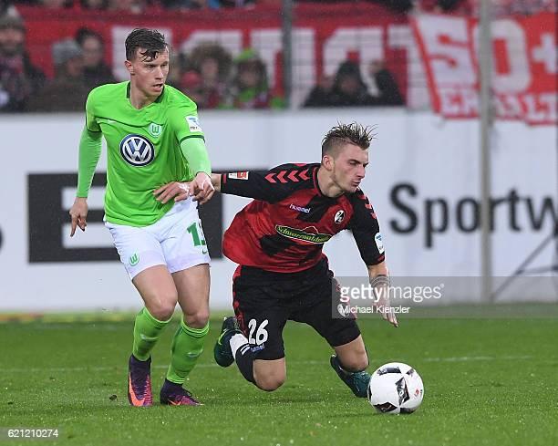 Maximilian Philipp of SC Freiburg challenges Yannick Gerhardt of VFL Wolfsburg during the Bundesliga match between Sport Club Freiburg and VfL...