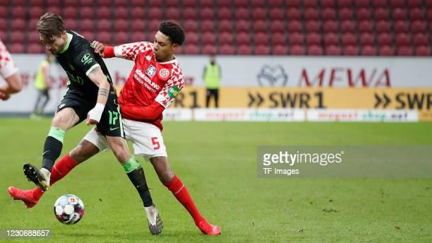 Maximilian Philipp of VfL Wolfsburg and Jean-Paul Boetiu of 1. FSV Mainz 05 during the Bundesliga match between 1. FSV Mainz 05 and VfL Wolfsburg at...