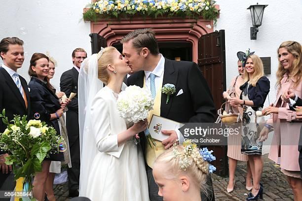 Maximilian Prinz zu Sayn Wittgenstein-Berleburg and his wife Franziska Balzer kiss after the wedding of Prince Maximilian zu...