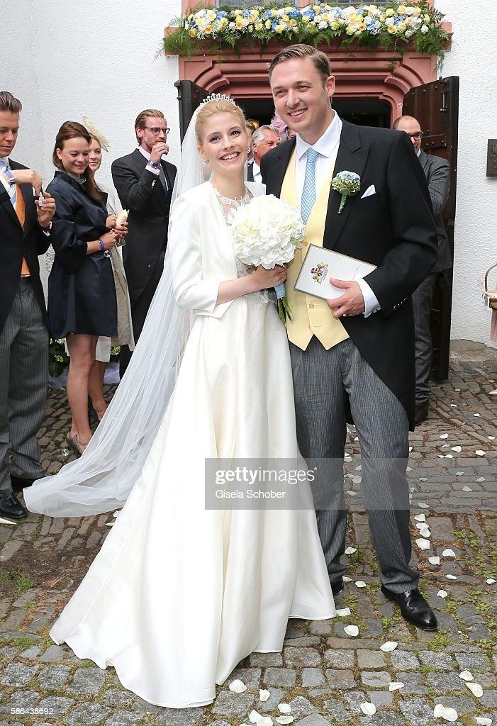 Maximilian Prinz zu Sayn Wittgenstein-Berleburg and his wife Franziska Balzer after the wedding of Prince Maximilian zu Sayn-Wittgenstein-Berleburg and Franziska Balzer on August 6, 2016 in Bad Laasphe, Germany.