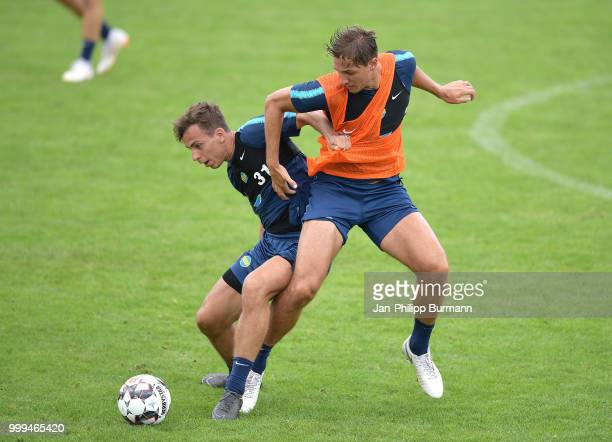 Maximilian Pronichev and Niklas Stark of Hertha BSC during the training camp at VolksparkStadion on July 15 2018 in Neuruppin Germany