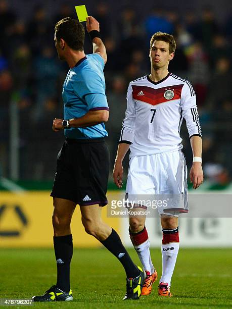 Maximilian Thiel of Germany is shown a yellow card by Referee Piero Giacomelli during the under 20 International friendly match between U20 Germany...