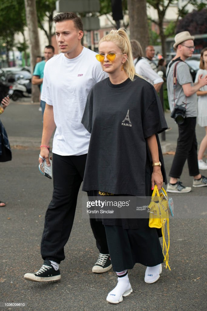 Maximilian wearing a Vetements T shirt with Fashion blogger Palina Kozyrava wearing all Vetements and Balenciaga bag during Haute Couture Fall Winter 2018/2019 on July 1, 2018 in Paris, France.