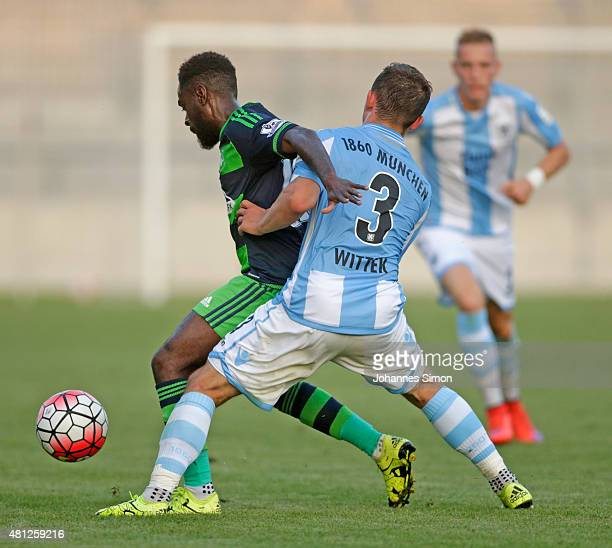 Maximilian Wittek of 1860 Muenchen battles for the ball with Nathan Dyer of Swansea during the preseason friendly match between TSV 1860 Muenchen and...