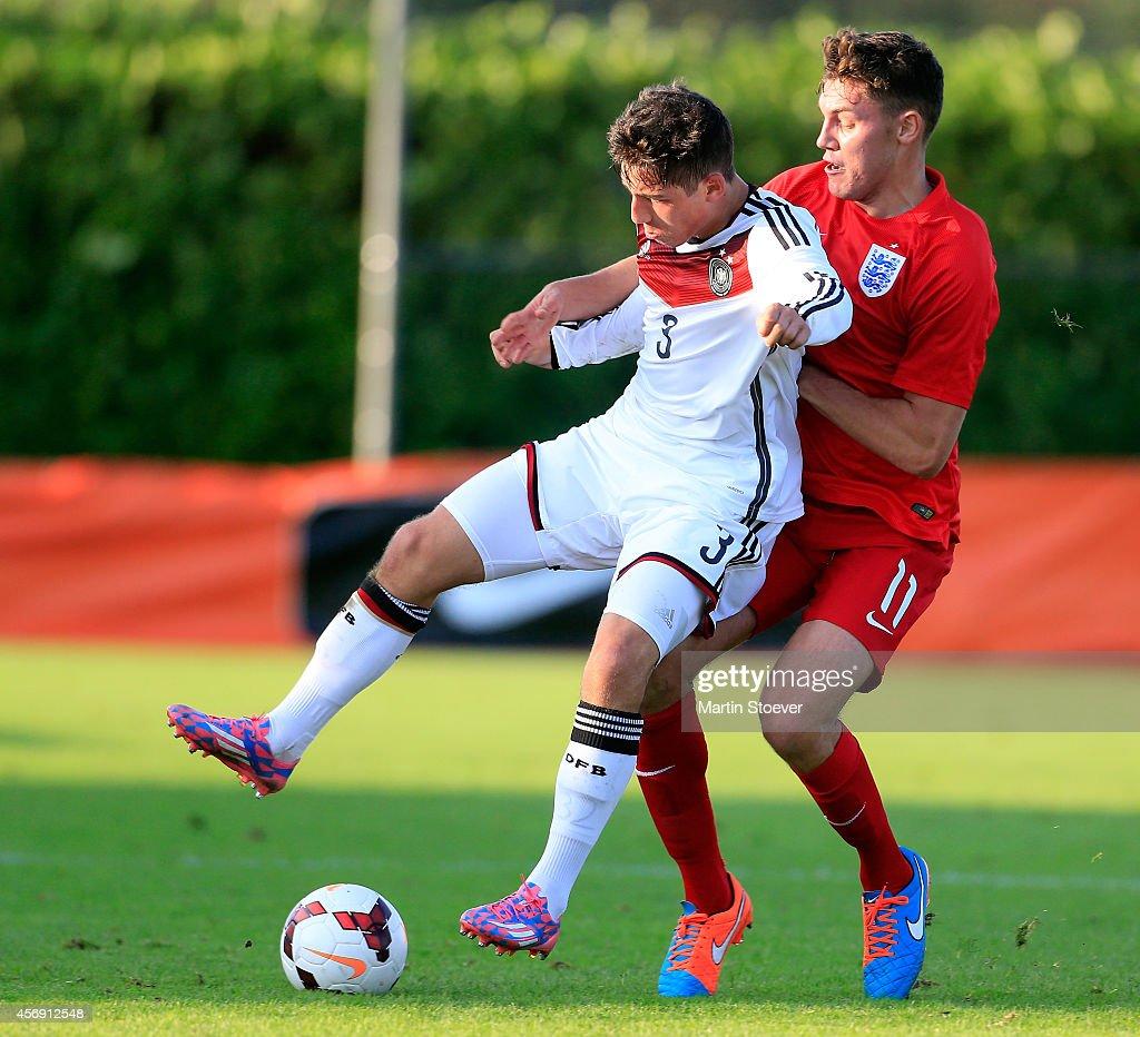 Maximilian Wittek of U20 Germany challenges Paul Digby of U20 England during the match between U20 Germany v U20 England at s Portpark Skoatterwald on October 9, 2014 in Heerenveen, Netherlands.