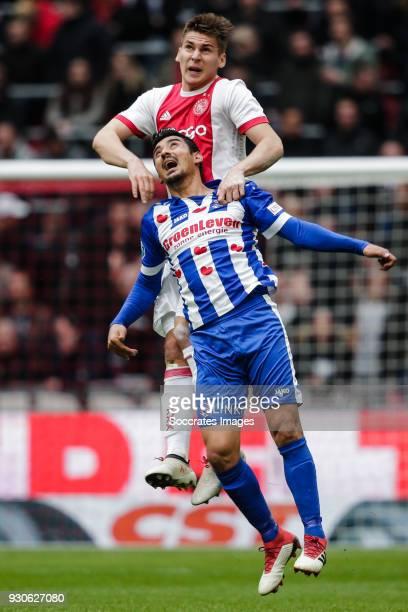 Maximilian Wober of Ajax Reza Ghoochannejhad of SC Heerenveen during the Dutch Eredivisie match between Ajax v SC Heerenveen at the Johan Cruijff...