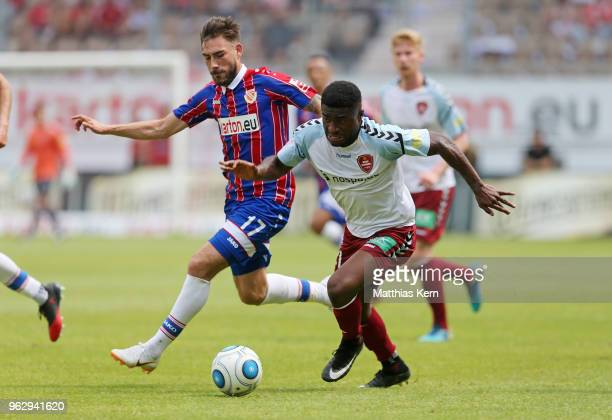 Maximilian Zimmer of Cottbus battles for the ball with Junior Ebot Etchi of Flensburg during the Third League Playoff Leg 2 match between FC Energie...